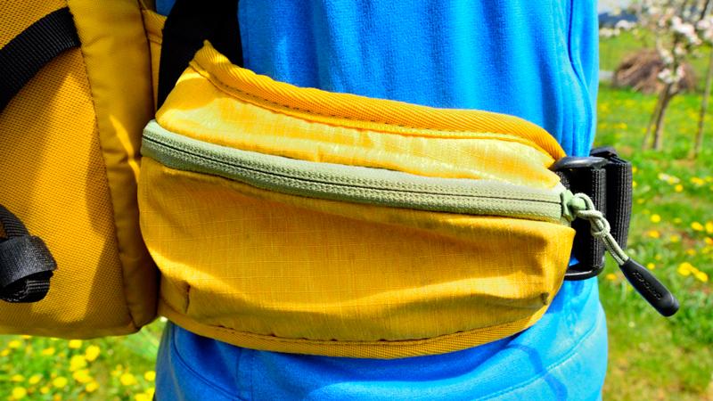 zaino con cintura ventrale a tasca